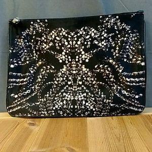 Alexander McQueen Bags - Alexander McQueen Diamond Print Skull Zip Clutch